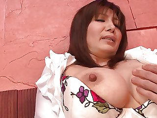 Busty brunette masturbates with a pink dildo